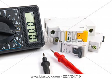 Electrical Modular Circuit Breaker And Digital Multimeter. Electrical Network Protection And Switchi