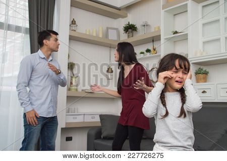 The Concept Of Parental Family Quarrels, Young Couple Parents Are Fighting In Front Of Children. The