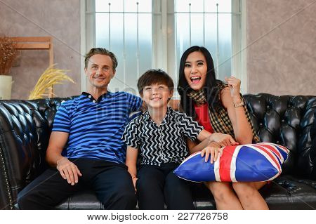 Family Concept. Family Is Happy In The House. The Family Is Playing In The Living Room. The Family L