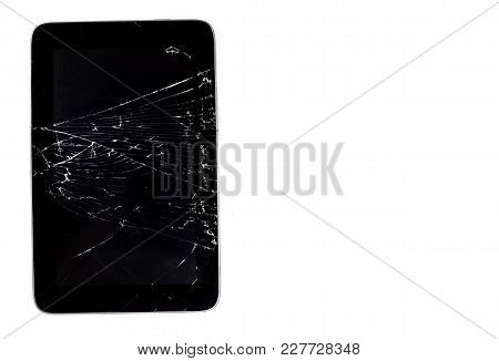 Tablet With A Broken Screen On A White Background.
