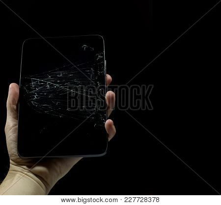 Tablet With A Broken Screen On A Black Background.