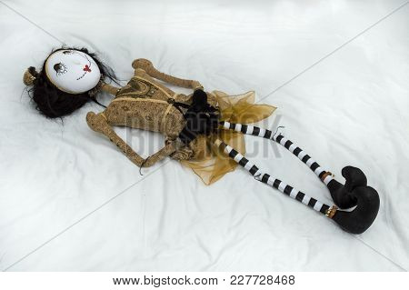 Creepy Steampunk Rag Doll Lying On Back With Legs Outstretched. High Angle View. Lifesize Doll On A