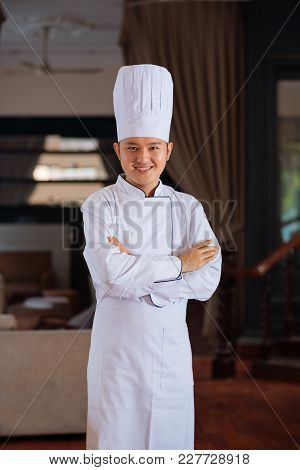 Portrait Of Happy Smiling Chef In Uniform Standing With His Arms Crossed