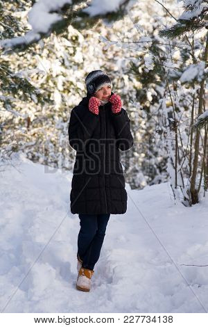 Girl In Red Gloves. In The Forest Tree Snow On The Branches.