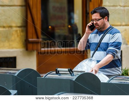 San Sebastian, Spain - September 27, 2016:man In The Process Of A Telephone Conversation Putting A P