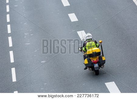 Benon, France - September 5, 2016:close-up Of A Biker Framing An Exceptional Convoy On The Road. He