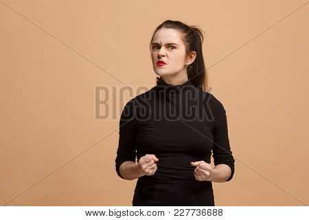 Angry Woman Looking At Camera. Aggressive Business Woman Standing Isolated On Trendy Pastel Studio B