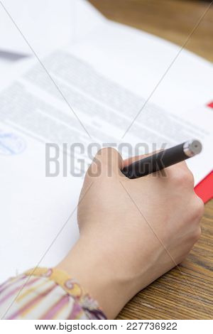 Woman Signing A Document