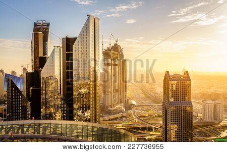 Bird's eye view of Dubai skyline and rush hour traffic in downtown