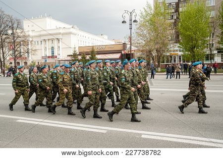 Tyumen, Russia - May 9. 2017: Paratroopers Pass Tyumen Columned Down The Street After Parade Of Vict