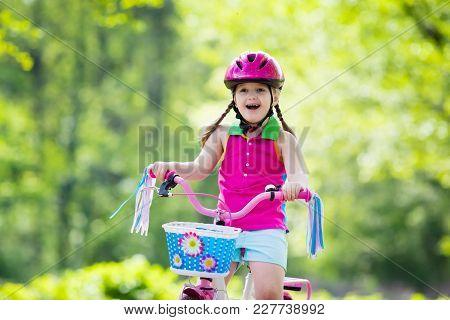 Child Riding Bike. Kid On Bicycle.