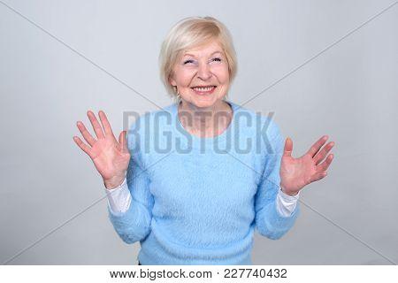 Happy Cheerful Woman. Senior Woman 70 Years Of Age.