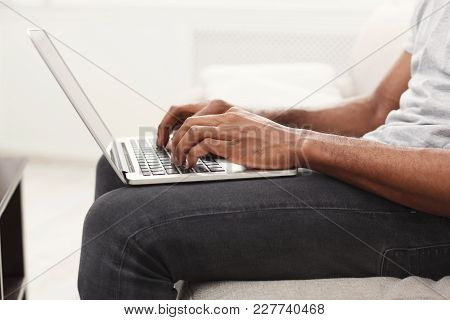 Closeup Of Man's Hands On Laptop Keyboard