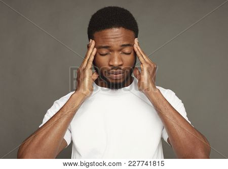 Headache. Concentrated Pensive Black Man Thinking About Something, Holding Fingers On Temple, Grey S