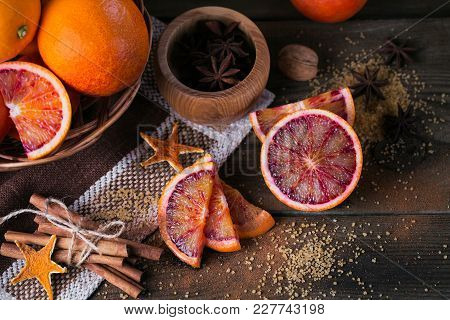 Ingredients For Making Candied Fruits. Fresh Red Orange Fruit, Spices And Brown Sugar On Rustic Wood