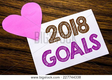 Conceptual Hand Writing Text Showing 2018 Goals. Concept For New Yer Resolutions Written On Sticky N