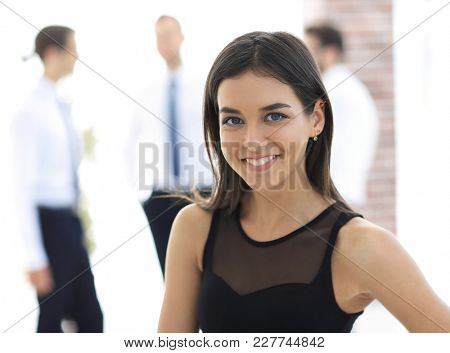 portrait of young business woman on blurred background.