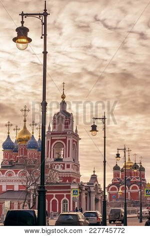 European Landmark And Tourist Center Of Moscow On A Background Of Scarlet Red Sky Of Sunset And The