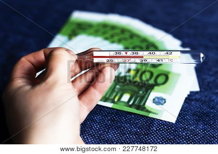 The Thermometer On The Background Of Money, To Be Sick Is Expensive