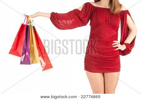 youmg woman with bags isolated on white