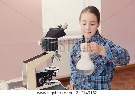 Girl Doing Chemical Experiment With Liquid Nitrogen In Laboratory, Copy Space. Early Development, Di