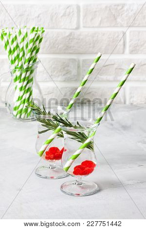 Coctail Party, Soda Drink Served With Rosemary And Berries, Jug With Striped Green Straws On White P