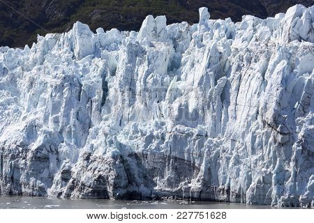 The Close View Of A Glacier In Glacier National Park (alaska).