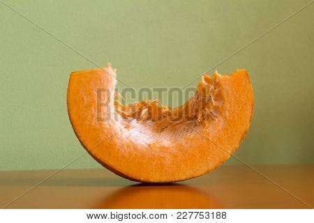 Chopped Pumpkin On A Brown Dark Wooden Table Home Cooking