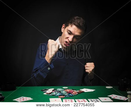 Man Is Playing Poker. Emotional  Card Player Win In Game, Man Very Happy With Making Right Choices,