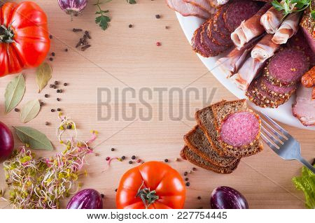Frame Of Different Appetizer, Like Jamon, Bacon, Salami And Pieces Of Bread With Different Vegetable