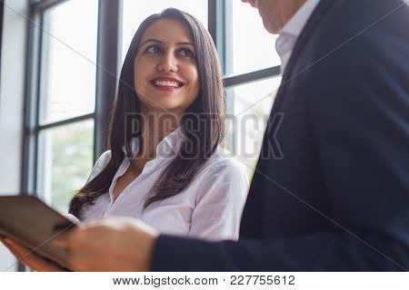 Cheerful Ambitious Business Assistant Presenting Report To Boss While Discussing Business Plan. Happ