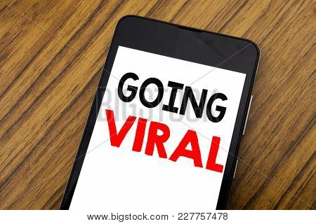 Word, Writing Handwriting Going Viral. Business Concept For Social Viral Business Written On Mobile