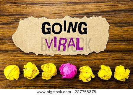 Handwriting Text   Going Viral. Concept For Social Viral Business Written On Sticky Paper Reminder,
