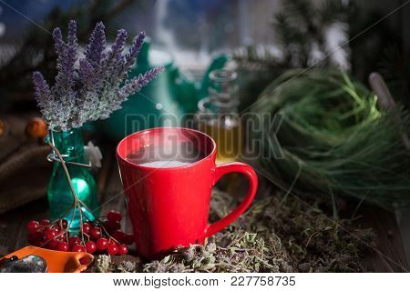 Herbal Tea From The Viburnum Decoction Of Red Sea Buckthorn Berries And Thyme In A Transparent Glass