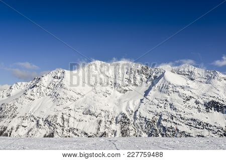 Stunning View Of High Mountain Peaks In The Italian Alpine Arc, In A Bright Sunny Day And Lot Of Can