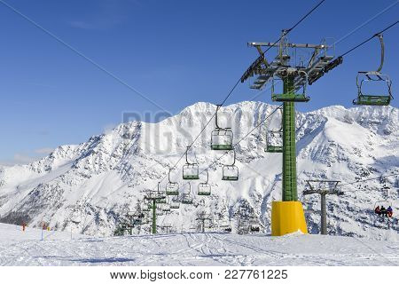 La Thuile, Italy - Feb 18, 2018: Chairlift At Snow Covered Italian Ski Area In The Alps - Winter Spo