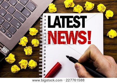 Conceptual Hand Writing Text Caption Latest News. Business Concept For Fresh Current New Story Writt