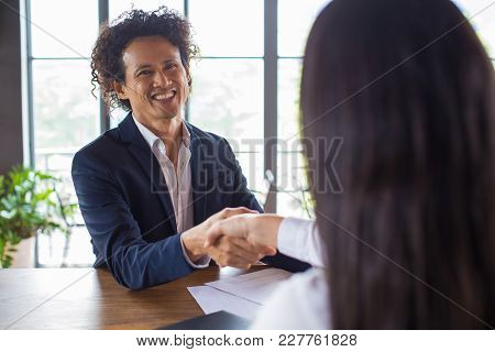 Cheerful Asian Businessman Satisfied With New Partnership. Smiling Handsome Mixed Race Male Manager