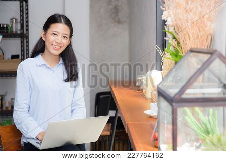 Beautiful Asian Young Woman Working Online On Laptop Sitting At Coffee Shop, Professional Female Fre