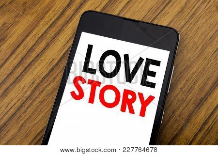Word, Writing Handwriting Love Story. Business Concept For Loving Someone Heart  Written On Mobile P