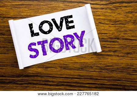 Word, Writing Love Story. Business Concept For Loving Someone Heart  Written On Sticky Note Paper On