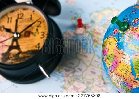 Planing For Travel To France Paris With Worldmap Globe And Alarm Clock. Travel Time In Europe Concep