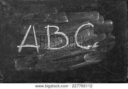 Chalkboard Texture. Washed Blackboard Backgroud With Letter Abc