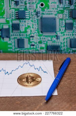 Bitcoin Golden Coin Pen And Charton Wooden Table