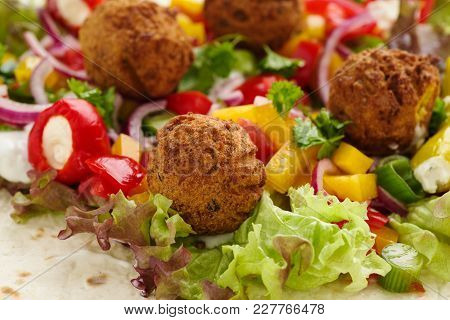Fresh Falafel With Veggies, Red Onions And Salad
