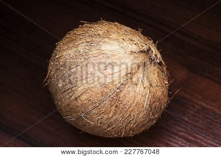 Coconut On A Wooden Background.