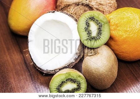 Citrus Fruits On A Wooden Background