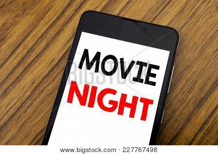 Word, Writing Handwriting Movie Night. Business Concept For Wathing Movies  Written On Mobile Phone,