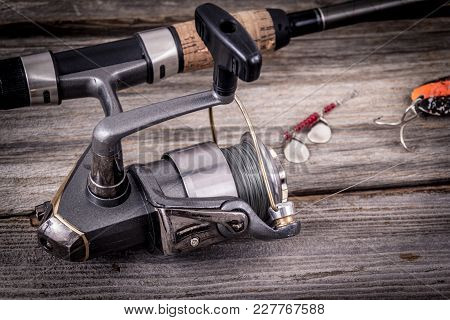 Fishing Rod With Lure Over Wood Background