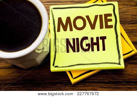 Handwritten Text Showing Movie Night. Business Concept For Wathing Movies  Written On Sticky Note Pa